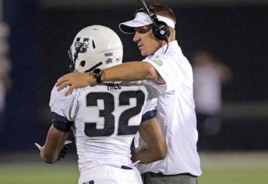 Gary Andersen takes time to say good-bye to Utah State players.